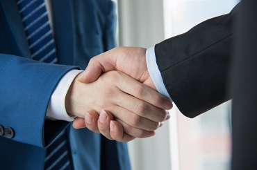 aftersales service - two businessmen shaking hands